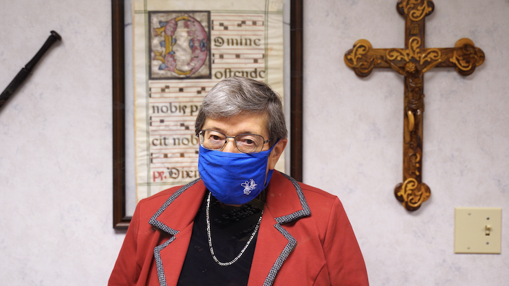 sister joan wearing a mask