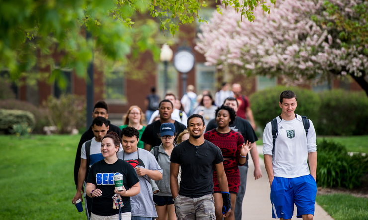 group of students walking on campus