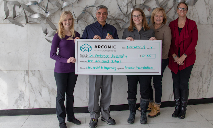 Engineering student and professor accept a check from the Arconic Foundation