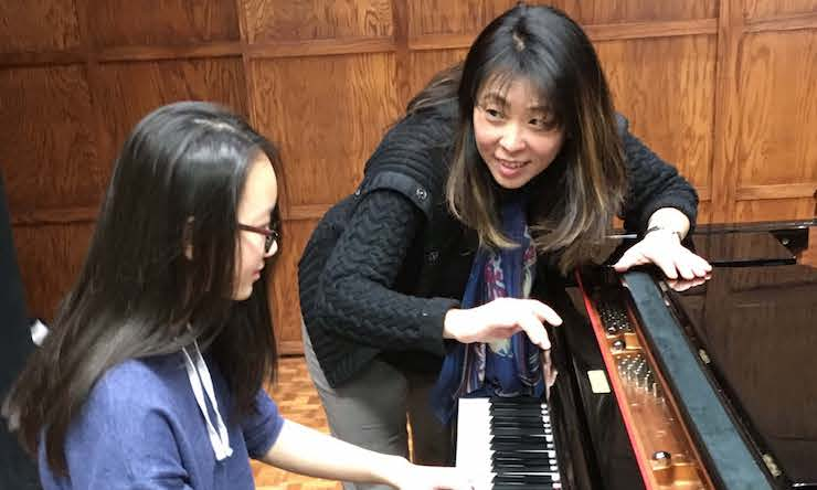 marian at piano with student